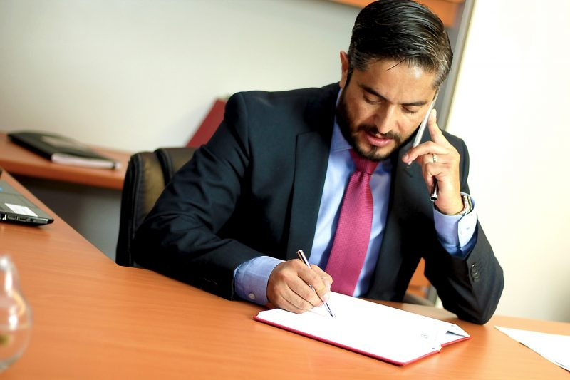 Business man sitting at a desk on the phone